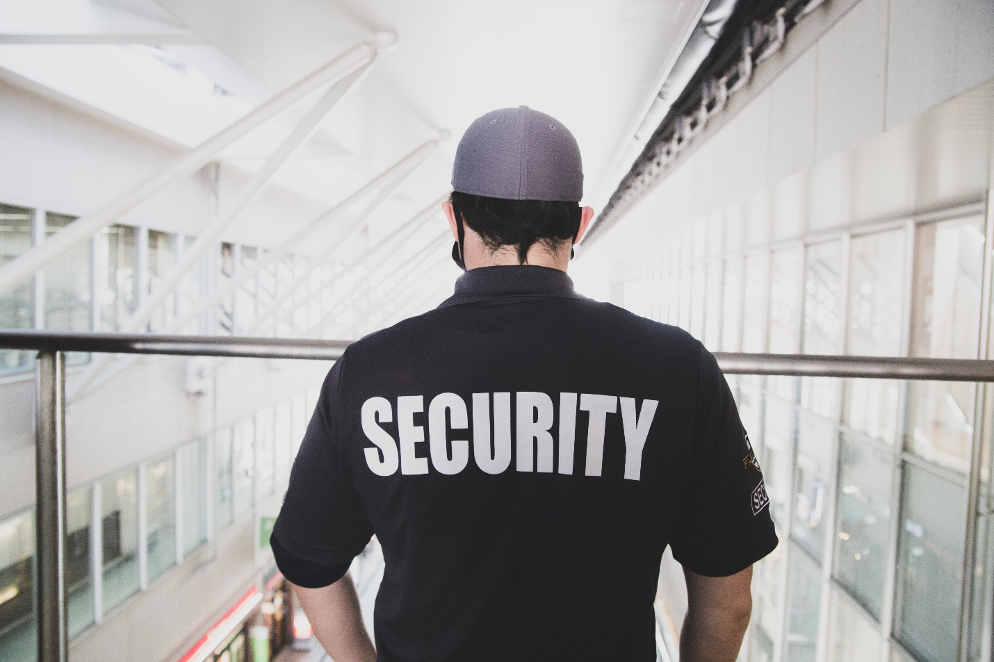 Security guard standing on a balcony