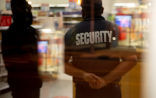 A blurry image of a security guard
