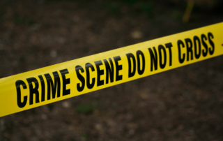 Do-not-cross yellow tape at a crime scene