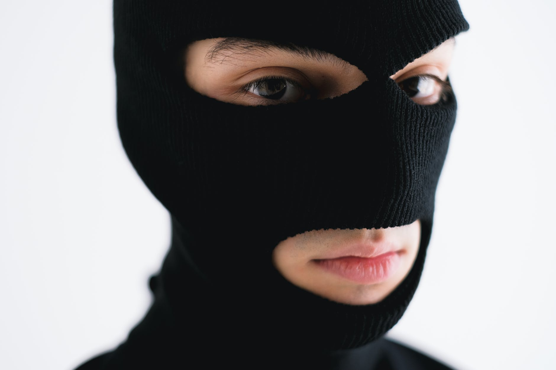 A person in a burglar mask